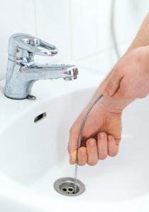 Using a Zip-It or Snake-It tool is a great way to unclog unwanted hair in your drain.